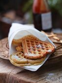 Heart-shaped buttermilk and banana waffles in a white napkin