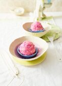 Cake balls with cherry filling and pink glacé icing