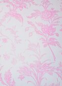 A background with a pale pink floral pattern