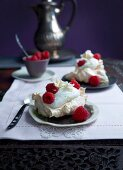 Lime and buttermilk espuma in meringue baskets with raspberries