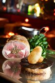 Saddle of lamb with a side of potatoes