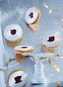 Vanilla Linzer biscuits (nutty shortcrust jam sandwich biscuits with holes on top) with Christmas decorations