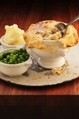 Chicken pot pie with peas and mashed potato (England)