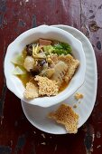 Crispy rice with vegetarian sausage, dumplings, mushrooms, bamboo and vegetables