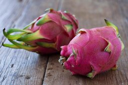Half a Dragon Fruit with a Spoon Stuck in It