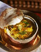 Lamb curry with a pastry lid (India)