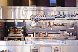 A Professional Kitchen with Hanging Pans of all Sizes