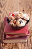 Amaretti (almond biscuits, Italy) with dried fruits on a stack of books