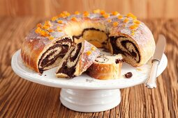 Poppy seed roulade, partly sliced, a cake stand