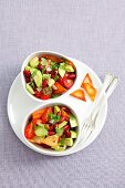 Tomato and avocado salad with kidney beans and tortilla chips