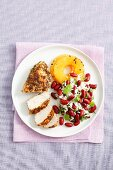 Chicken breast with rice, kidney beans, coriander leaves and grilled pineappe