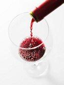 Wine Splashing into a Glass