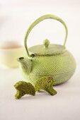 An arrangement featuring a teapot and matcha biscuits