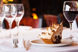 A Slice of S'more Pie on a White Plate on a Dinner Table