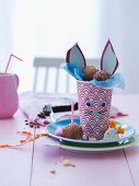 Paper cup decorated with Easter & filled with pastry balls