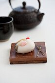 Wagashi crane (for New Year) with a teapot (Japan)