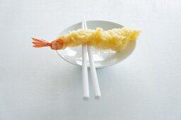 Tempura prawn in a bowl with chopsticks (Japan)