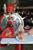 Parma ham being sliced by a machine