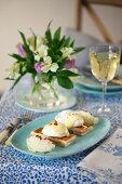 Eggs Benedict on toasted ham sandwiches