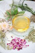 Aromatised women's tea in a glass teacup