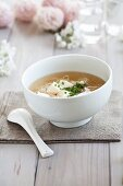 Chicken broth with tofu, noodles and chives