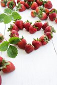 A heart made of strawberries with leaves