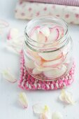 Rose petals in a jar on a pan holder