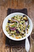 Rice with colourful lentils, almonds and red onions