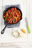 Mini sausages with peppers and onions