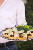 A Platter of Toasts with Cheese, Walnits and Scallions