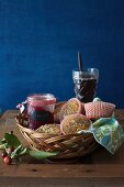 Oat Muffins with a Jar of Jam in a Basket