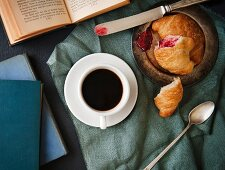 Afternoon coffee; with croissants with jam filling