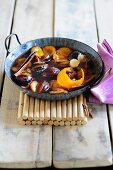 Stewed plums with cinnamon and orange peel
