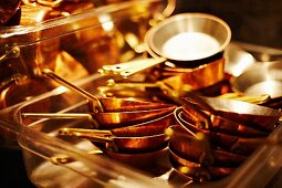 Pans stacked up in a restaurant kitchen