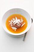 Orange soup with chocolate ice cream
