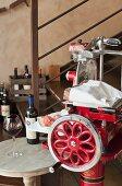 A slicing machine for prosciutto in a wine shop