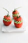 Tomatoes filled with pesto cream