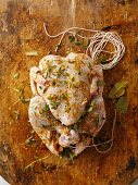Chicken with herbs and spices, ready for roasting