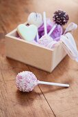 Assorted cake pops in a wooden box as a gift