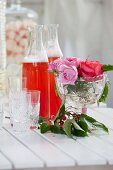 Close-up of lemonade ion bottles and roses