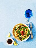 Oriental noodle dish with fish and vegetables