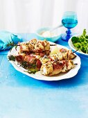 Rosemary and fish skewers with Parma ham