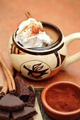 Mexican hot chocolate with cinnamon sticks and chocolate