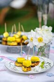 chicken and mango skewers on a baptism party table