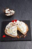 Coconut ice cream torte with heart decoration