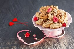 Meringues with cinnamon, nuts and rosebuds