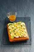 Coconut sponge cake with tropical fruits