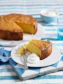 Citrus fruit and polenta cake, one slice cut