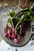 Beetroot, whole and cut in half, on a metal tray