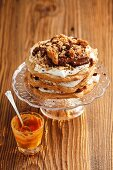 Chocolate meringue layer cake with sesame brittle and caramel